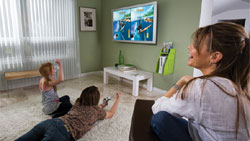 Family Gaming From A GameOn Video Gaming Console Storage Unit