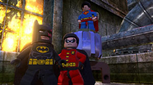 Batman, Robin and superman posing together in Lego Batman 2: DC Super Heroes