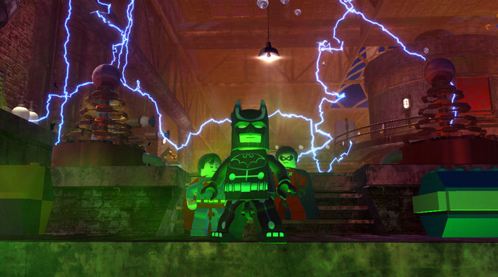 Superman, Batman, and Robin posing in a dramatic pose together in Lego