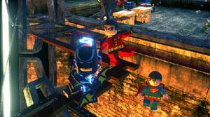 Batman, and Robin platforming, while Superman floats in Lego Batman 2: DC Super Heroes