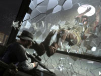 Max breaking through a pane of glass to surprise an enemy in Max Payne 3