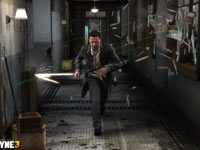 Max hustling to avoid a spray of bullets in Max Payne 3