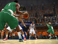 Michigan State player cutting to the hoop against an Illini defender in NCAA Basketball 10