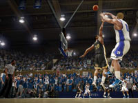 Duke player getting a 3-pointer off over a Wake Forest defender in NCAA Basketball 10