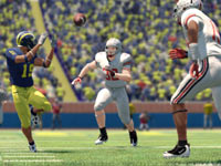A Michigan State reciever catching a pass against the Ohio State secondary in NCAA Football 13