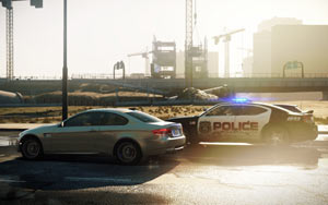 The police neck and neck with the driver in Need for Speed: Most Wanted