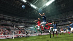 Leaping for a ball in front of the goal in Pro Evolution Soccer 2012