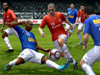 Defender going for the tackle in Pro Evolution Soccer 2011