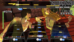 A singer and bassist rocking it tight in multiplayer mode in Rock Band Track Pack: Volume 2