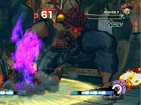 Evil Ryu finishing Akuma with a combo in Super Street Fighter IV: Arcade Edition