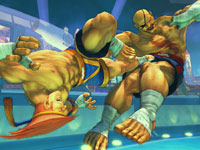 Adon delivering a devastating kick to the gut of Sagat in Super Street Fighter IV