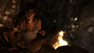 Lara Croft warming herself by a fire in Tomb Raider