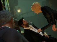 Drake in the clutches of a female enemy in Uncharted 3: Drake's Deception