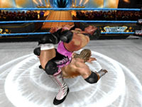 Brett Hart putting a submission hold on Triple H in WWE All-Stars for PS2
