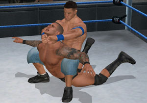 Cena locking a submission hold into place in WWE Smackdown vs Raw 2010 for Wii