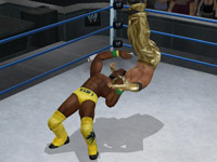 Kofi laying a suplex on Mysterio in WWE Smackdown vs Raw 2010 for Wii