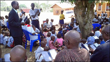 Students in Africa gather outside with their Kindles