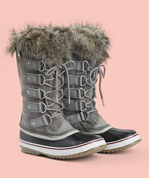 Boots. Image of a sage green Sorel Joan of Arctic Boot