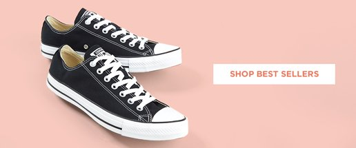 Best Sellers. Image of black chuck taylor converse shoes,