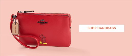 Shop Handbags. Image of a red Coach Mickey wristlette
