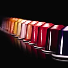 Image shows multiple colours of nespresso capsules