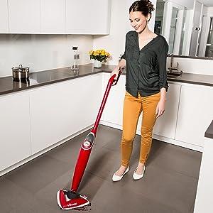 Woman using Vileda 100 Hot Spray Mop