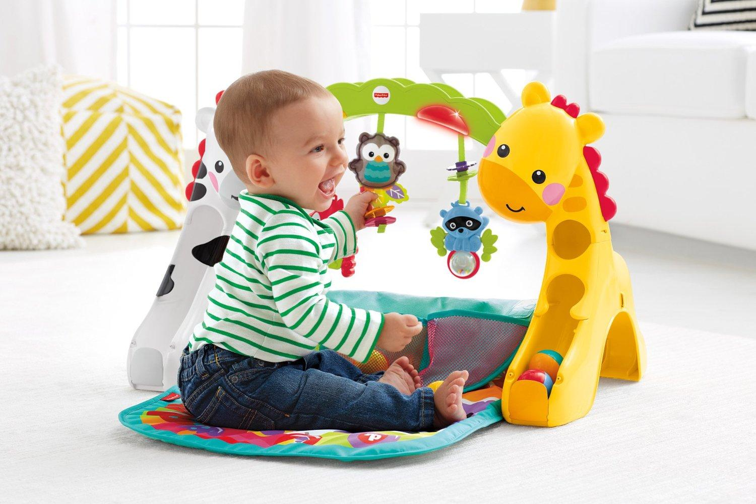fisher price tapis de jeu volutif musical pour b b avec plus de 12 activit s et jouets d s la. Black Bedroom Furniture Sets. Home Design Ideas