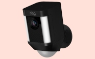 Ring Spotlight Camera on coral background. On sale for $184.99 was $249.99