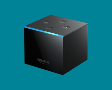 Control your TV hands-free. Fire TV Cube on blue background.