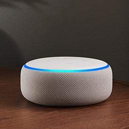 Image of a white Echo Dot device on a table.