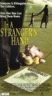 In a Stranger's Hand [VHS]
