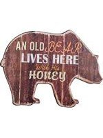 An old bear lives here with his honey wall plaque