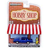 1984 Chevrolet Monte Carlo SS Blue with Vintage Gas Pump The Hobby Shop Series 5 1/64 Diecast Model Car by Greenlight 97050 F
