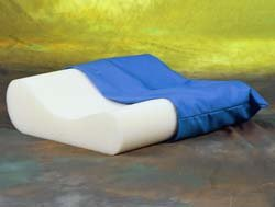 Pillow - Ortho U Pillow Soft polyurethane foam with height variations for different comfort levels. Aids in the reduction of cramps and stiff neck during sleep. Comes with a removable, washable cover. by King Products