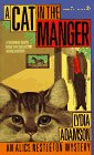 book cover of A Cat in the Manger