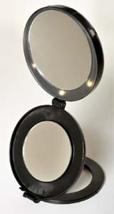 floxite compact mini vanity mirror magnifies 10x with led lights and. Black Bedroom Furniture Sets. Home Design Ideas