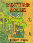 Two children walk through the woods with a guide, exploring trails and observing nature around them.