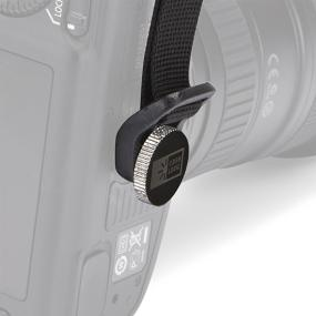 The Case Logic DHS-101 Quick Grip screwing into a camera