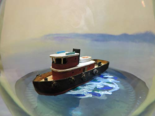Ship in a bottle, Tug Boat cruising on a blue sea