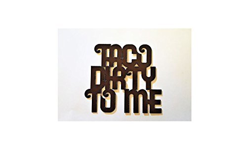 Taco Dirty To Me Sign made out of rusted metal