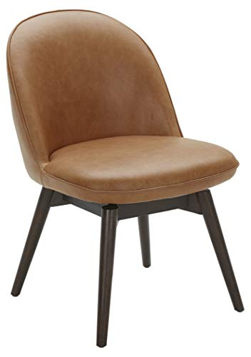 "Amazon Brand – Rivet Contemporary Leather Dining Chair with Swivel Seat, 33""H, Cognac - The swivel seat of this chair allows for greater mobility in any dining area. The stain-resistant and moisture-repellent leather upholstery means that caring for this item will be simple. Its cognac color can match most dining room decorations, and the solid wood frame gives it sturdy construction. 21""W x 24""D x 33""H; seat height: 19""H; seat depth: 18""D; seat back height: 14""H Solid wood frame; top grain leather - kitchen-dining-room-furniture, kitchen-dining-room, kitchen-dining-room-chairs - 310xuaAra3L -"