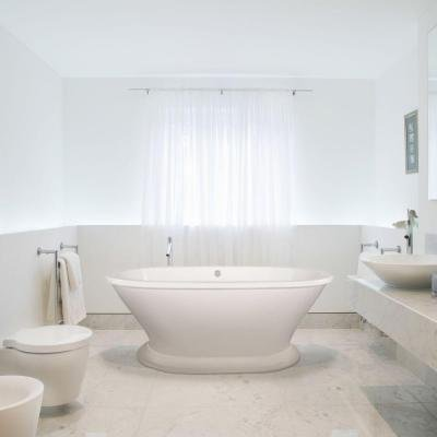 Columbia 5.8 ft. Acrylic Center Drain Freestanding Oval Air Bath Tub in Biscuit