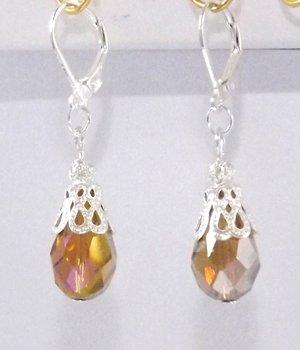 1 Boucles d'oreilles argentée – perle ambre irisé.