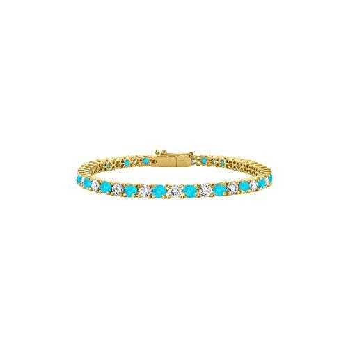 Created Blue Topaz and CZ Tennis Bracelet in 18K Yellow Gold Vermeil. 2CT. TGW. 7 Inch