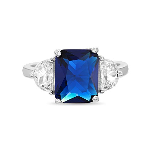- INSPIRED BY YOU. Radiant Cut Simulated Blue Sapphire and Half Moon Cubic Zirconia Cocktail Ring for Women in Rhodium Plated Sterling Silver (Size 7)