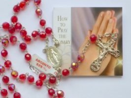(925 Tin Cut Crystal Ruby Rosary with Prayer Card.)