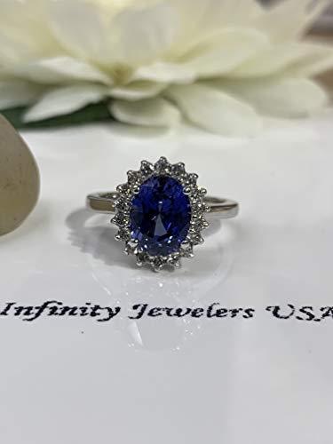 Oval cut Ceylon blue sapphire, diamond halo engagement ring ()