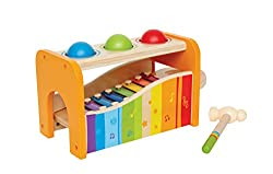 Hape's Pound and Tap Bench with Slide Out Xylophone is a multifunctional musical delight and sound experience for toddlers. Toddlers ages 12 months to 3 years can explore different notes and sounds by letting the balls fall on the keys or slide out t...