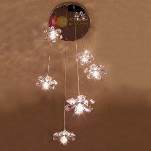 loco lampadario con luci pendenti e paralumi in cristallo a forma di gelsomino ideale
