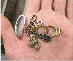 50-shades-of-grey-trilogy-black-grey-tie-handcuffs-mask-large-key-chain-with-number-50